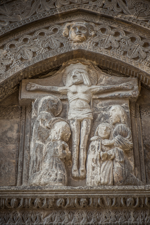 conversano: Jesus Christ  bas-relief on the portal of the mother church in Conversano, Italy Stock Photo