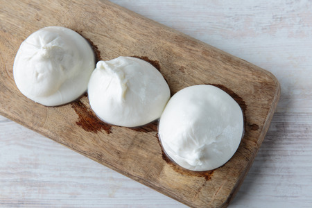 typical: Fresh delicious burrata cheese typical from Apulia region, Italy