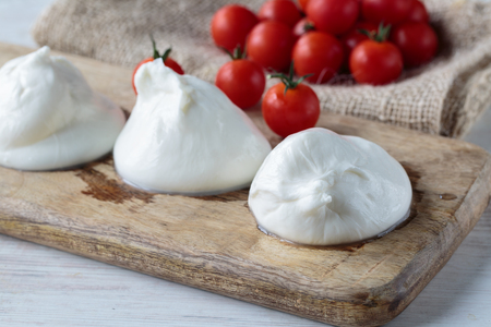 Fresh delicious burrata cheese typical from Apulia region, Italy