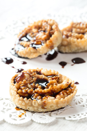 Cartellate, traditional home made pastries filled with figs syrup Stock Photo