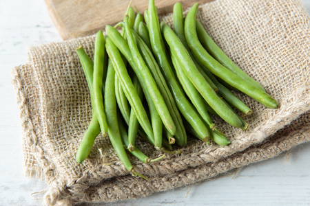 green beans: Fresh raw green beans on jute cloth Stock Photo