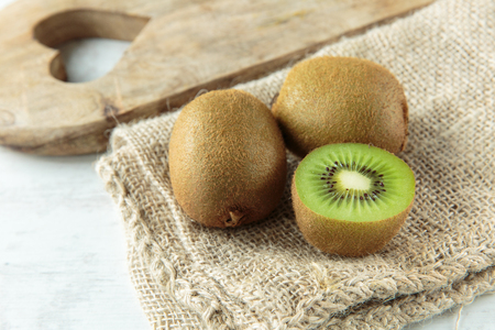 fruit: Delicious fresh kiwi fruit on a chopping board Stock Photo