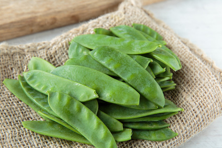 Fresh raw snow peas for an healthy meal