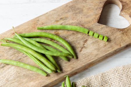 greenbeans: Fresh raw green beans on a chopping board