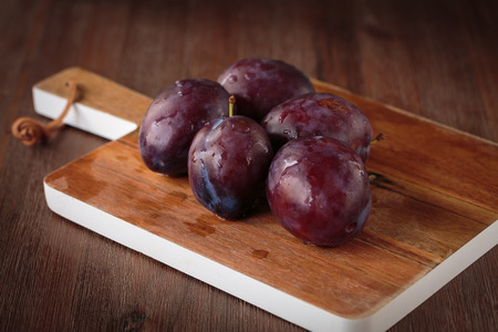 purple leaf plum: Fresh juicy purple plums Stock Photo