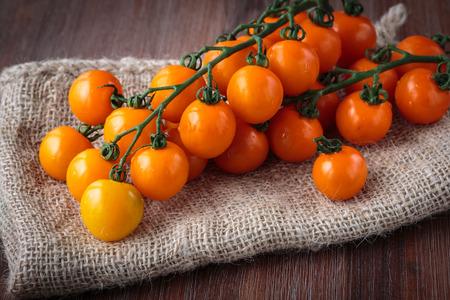 cherry tomatoes: Fresh raw orange cherry tomatoes Stock Photo