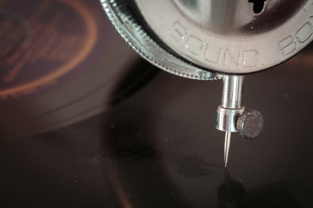 antique phonograph: Closeup of a  turntable needle from a vintage phonograph