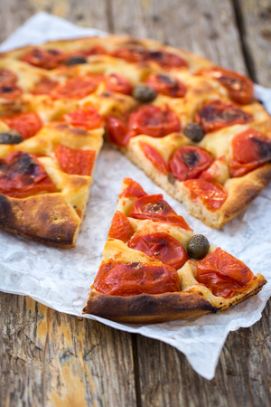 Delicious italian home made focaccia bread with tomatoes Stock Photo