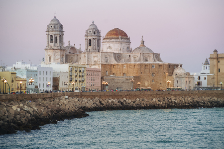 Sunset over the wonderful Cathedral of Cadiz, in Andalusia, Spain