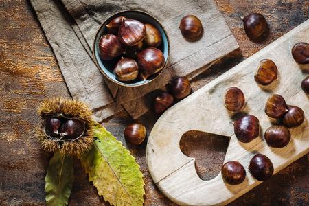 Fresh raw chestnuts fruits in autumn season