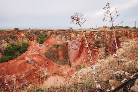 old bauxites red soils quarry cave in Spinazzola, Apulia region 스톡 콘텐츠