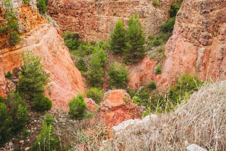 old bauxite's red soils quarry cave in Spinazzola, Apulia region