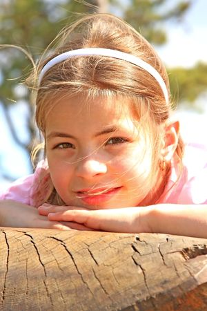 nine years old:   Beautiful, nine years old �pretty lady� on the bench
