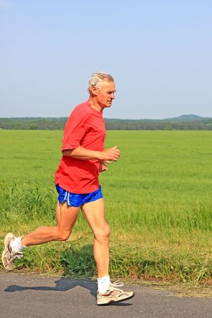 Senior runner while training for a competition