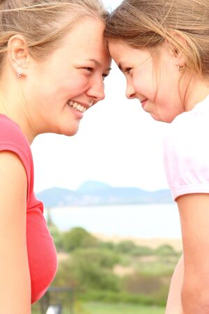 Beautiful, young sisters enjoy life in front of the camera Stock Photo - 4920690