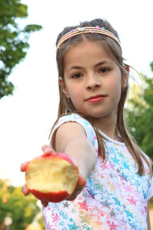 nine years old: Beautiful nine years old �pretty lady� in front of the camera with apple