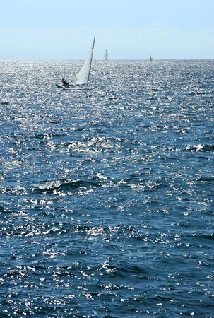 One sailboat sails quickly thanks to the strong wind