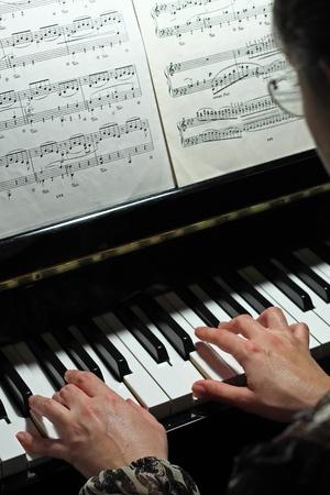 Beautiful, harmonious detail of a black piano
