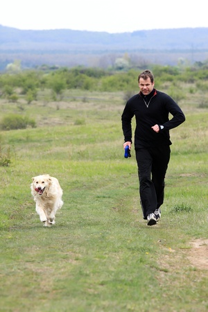 A young man running with your dog photo