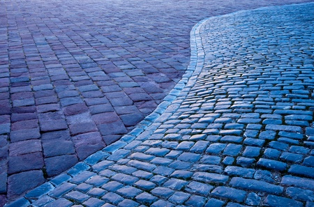 interstice: Fine, gray cobbled street