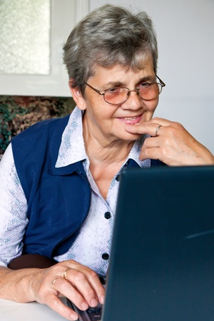 Senior lady learns with the computer Stock Photo