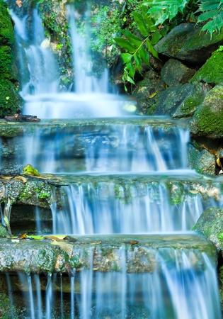 Beautiful veil cascading waterfalls, mossy rocks