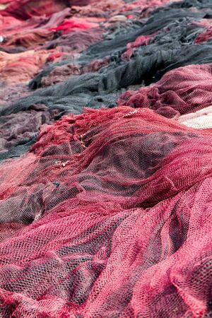 Red fishing nets drying on the port photo