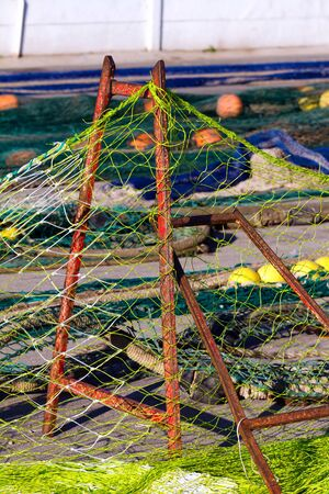 Fishing nets on the shore waiting for the repair photo