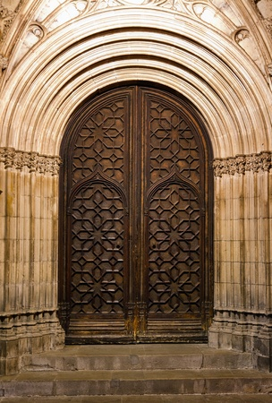 Beautiful old church door in Barcelona photo