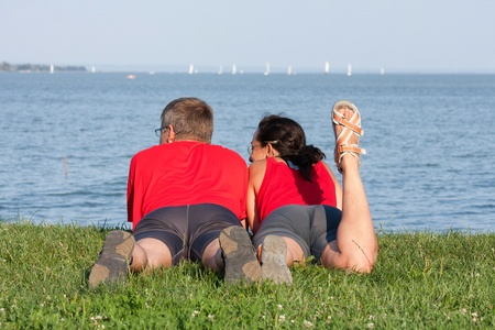 Joyful young couple is overlaping shore of the lake Stock Photo