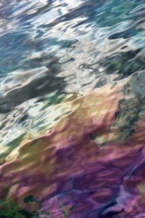 A close-up of the surface of oil pollution.