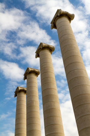 Four massive columns, blue sky Stock Photo