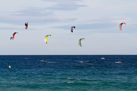 Seaside fun with kites in Spain photo