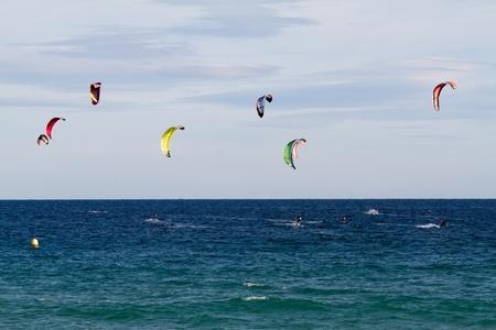 Seaside fun with kites in Spain photo