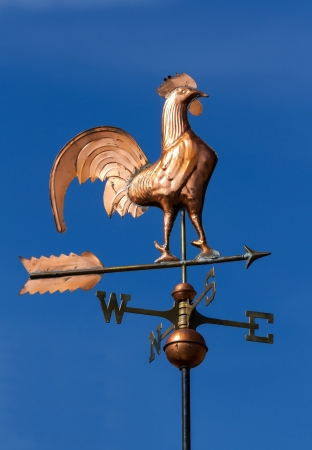 Wind cock direction on blue sky  Stock Photo - 14968051
