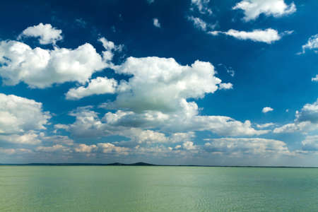 Beautiful lamb clouds above the lake photo
