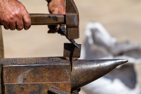 Iron forging is a very hard work photo