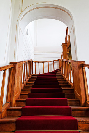 Stairs with red carpet in a castle photo
