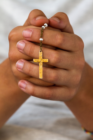 Praying with a rosary  photo