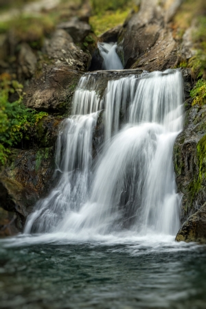 Beautiful veil cascading waterfalls, mossy rocks photo