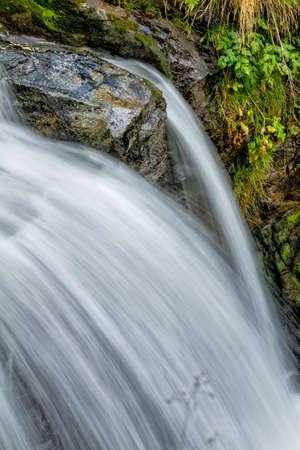gauzy: Beautiful veil cascading waterfalls, mossy rocks  Stock Photo
