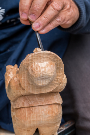 Skilful carver working in a small figure
