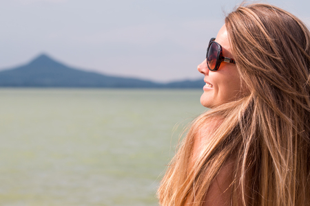 pretty blonde girl near the lake Archivio Fotografico