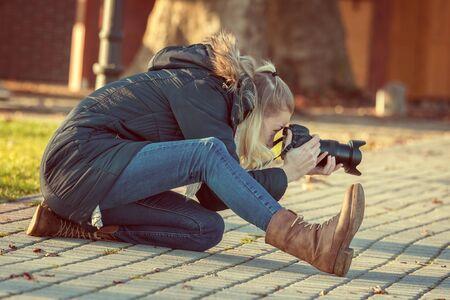 female photographer: Female photographer in action
