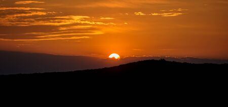 faintly visible: Sunset over the how Stock Photo