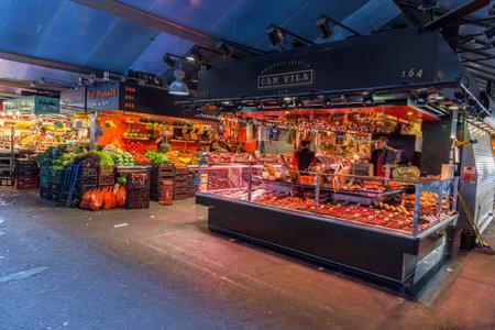 josep: BARCELONA, SPAIN - july 05 2016 : People buying food inside Mercat de Sant Josep de la Boqueria. It is a large public market in the Ciutat Vella district of Barcelona