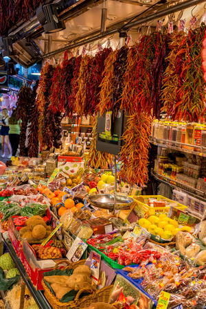 BARCELONA, SPAIN - july 05 2016 : People buying food inside Mercat de Sant Josep de la Boqueria. It is a large public market in the Ciutat Vella district of Barcelona