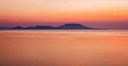 long lake: Sunrise over the lake Balaton of Hungary, long exposure