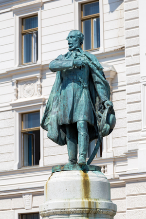 pecs: Historic building and statue Kossuth Lajos in Pecs, Hungary.