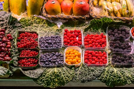 Famous La Boqueria market with vegetables and fruits in Barcelona, Spain Stock Photo